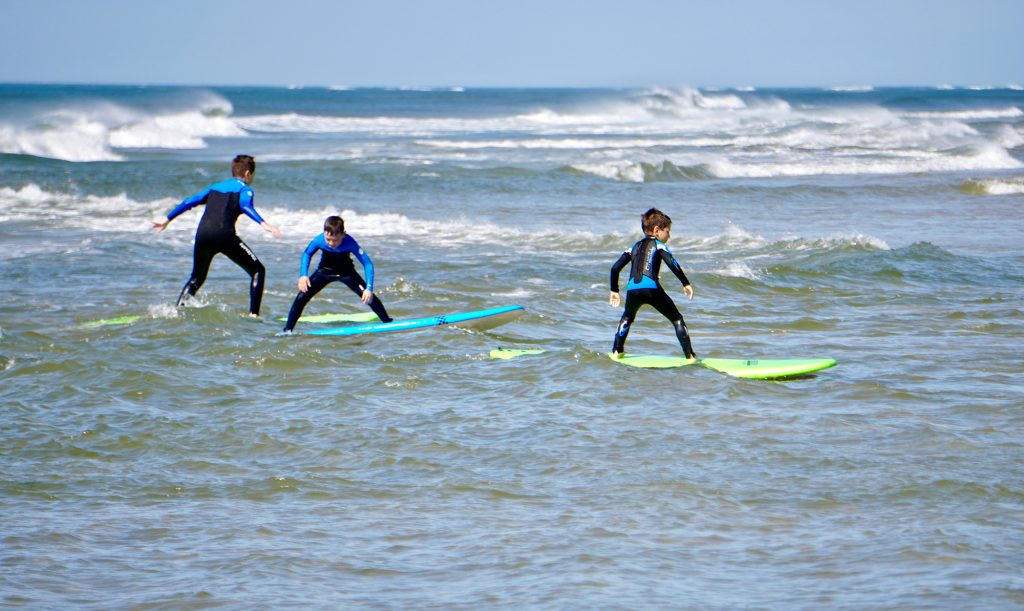 Learning how to surf on our soft top boards