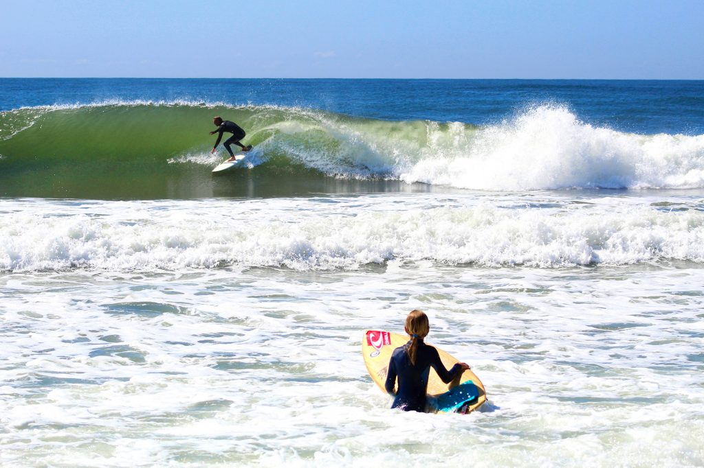 Surf instructor/camp director Ryan Saboe catching a wave between lessons